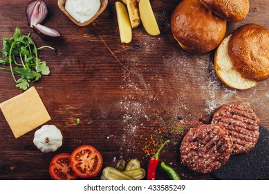 hamburger ingredients in a table with space for a logo