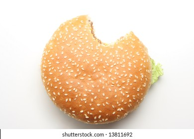Hamburger isolated on white, one bite taken out of it