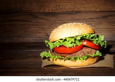 Hamburger. Juicy burger on a dark background