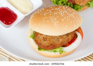 hamburger with meat on white dish.