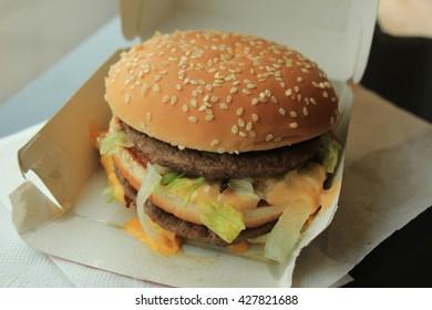 Hamburger on a bun in a carton box