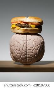 Hamburger on a human brain, food on the brain.
