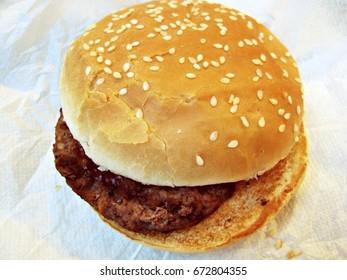 Hamburger on a white napkin.