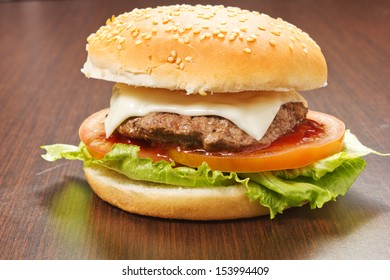 hamburger on the wood table with tomatoes
