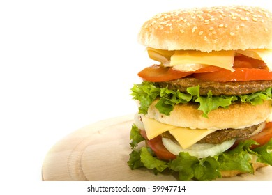 Hamburger on a wooden board isolated over white
