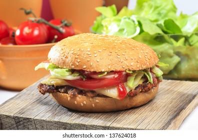 Hamburger on wooden tray