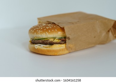 Hamburger in a paper bag on a white background. Isolate