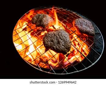 hamburger patty amateur bbq at night