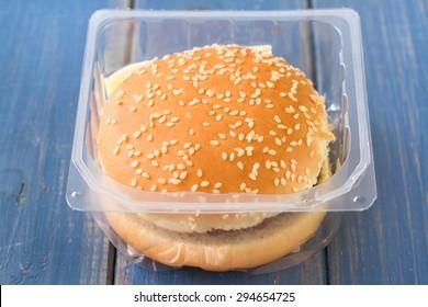hamburger in plastic box