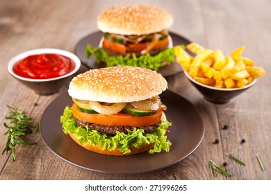 Hamburger with potato chips and ketchup