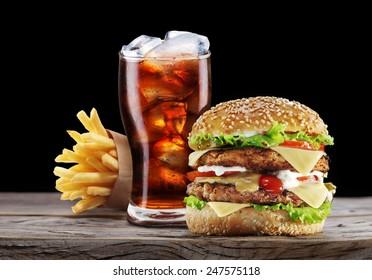 Hamburger, potato fries, cola drink. Takeaway food. Fast food.