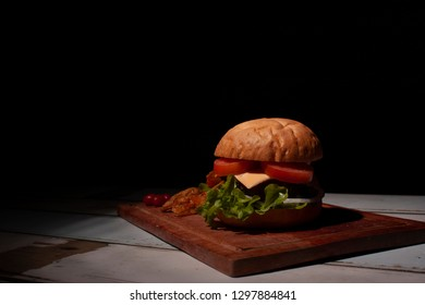 Hamburger prepared in Mexico City with black background
