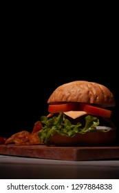 Hamburger prepared in Mexico City gourmet style food with black background