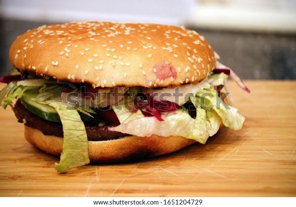 Hamburger and salad in a bun