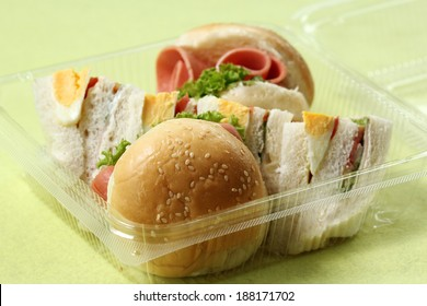 Hamburger and sandwich in box for take home / Selective Focus