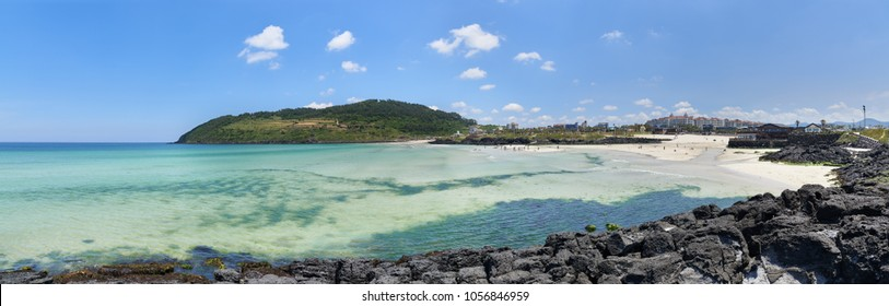 Hamdeok beach and Seoubong peak in Jeju, Korea. Hamdeok Beach is famous for its clean and blue water and white sand. And Seoubong is a peak near the Hamdeok beach and part of Olle trail course No.19.