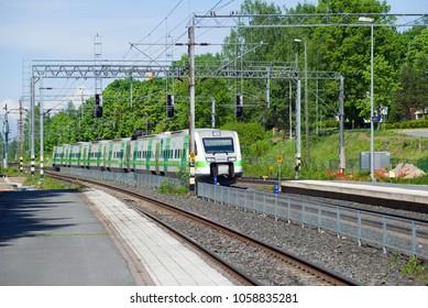 "HAMEENLINNA, FINLAND - JUNE 10, 2017: Sm3 ""Pendolino"" high-speed train at the Hameenlinna railway station on a sunny summer day"