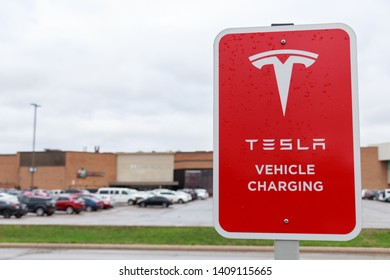 HAMILTON, CANADA - April 23rd, 2019: Tesla Vehicle Charging sign at Tesla Supercharger Station, CF Limeridge in Hamilton, Ontario.