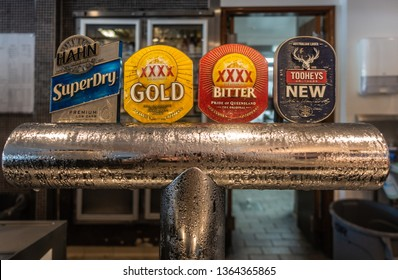 Hamilton Island, Australia - February 16, 2019: Closeup of Beer tap system at Mariners on the Marina serving Hahn Superdry, XXXX Gold, XXXX Bitter and Tooheys New ales.