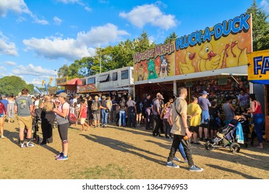 """Hamilton / New Zealand - March 23 2019: Sideshow Games at a Busy Fair. """"Laughing Clowns"""", """"Pluck a Duck"""" and """"Monster Mash"""""""