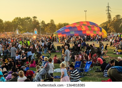 Hamilton / New Zealand - March 23 2019: A Half Inflated Hot Air Balloon Surrounded by a Large Crowd at the Balloons Over Waikato Festival