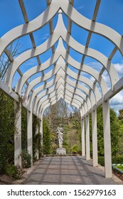 HAMILTON - New Zealand SEPTEMBER 19, 2019; White trellis with a Greek god statue in the Hamilton Gardens. Trademarks and license of Hamilton City Council. Editorial use.