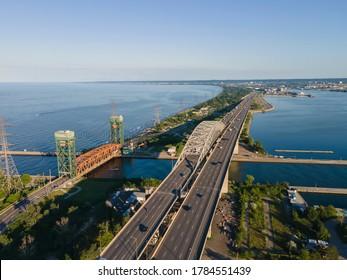 Hamilton, Ontario, Canada  Jul 24, 2020: Aerial panorama of a QEW highway and Skyway Bridge connecting Burlington and Hamilton. Urban environment and infrastructure, civil engineering concept.