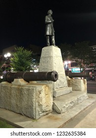 Hamilton, Ontario/ Canada - July 18 2018: Sir John A. Macdonald Statue with Naval Cannons in Gore Park.