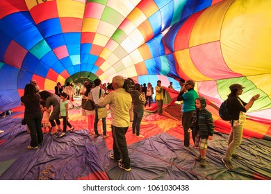 Hamilton, Waikato / New Zealand - 29 March 2014: People Going Inside a Partially Inflated Hot Air Balloon at the Balloons Over Waikato Festival