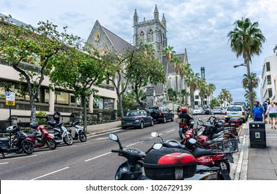 HAMILTON,BERMUDA, MAY 25 - Motor scooters are a popular way too sightsee around town as seen here by The Cathedral of the Most Holy Trinity on May 25 2016 in Hamilton Bermuda.