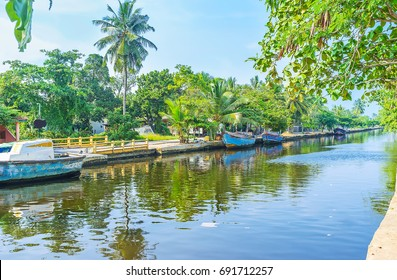 The Hamilton's Canal, stretching between Colombo and Negombo is surrounded by lush tropic gardens, palm plantations, villages, and forests, Wattala suburb, Sri Lanka.