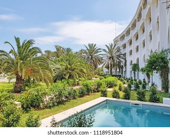 HAMMAMET, TUNISIA - JUNE 19, 2018: Facade of a Hammamet hotel. Hammamet  is a popular destination for its beaches, swimming and water sports