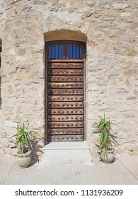 HAMMAMET, TUNISIA - JUNE 23, 2018: A wooden door in the Kasbah (Fortress) which is a medieval landmark located in Hammamet, Tunisia, North Africa