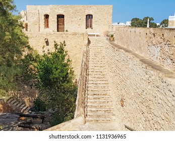 HAMMAMET, TUNISIA - JUNE 23, 2018: The internal stairs of the Kasbah (Fortress) which is a medieval landmark located in Hammamet, Tunisia, North Africa