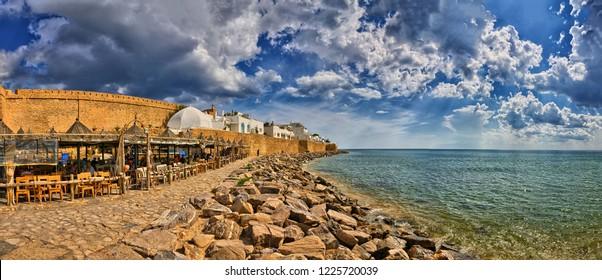 HAMMAMET, TUNISIA - OCT 2014: Cafe on stony beach of ancient Medina on October 6, 2014 in Hammamet, Tunisia