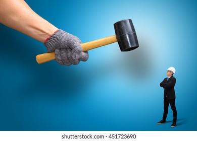 Hammer Against Business Man