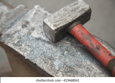 Hammer and anvil used by a blacksmith