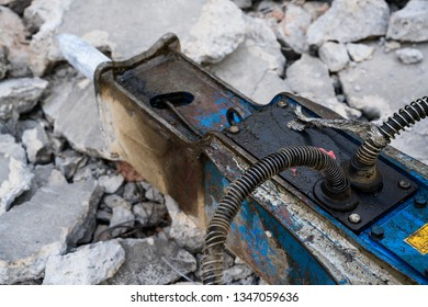 Hammer attached to excavator for drilling and breaking