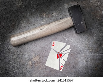 Hammer with a broken card, vintage look, ace of hearts