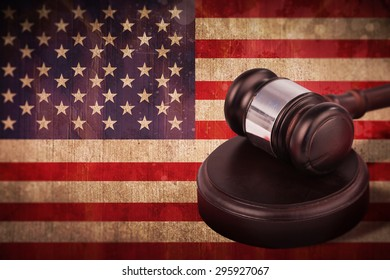 Hammer and gavel against usa flag in grunge effect