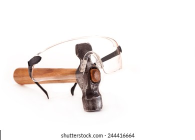 Hammer and goggles on a white background