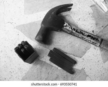 Hammer and iron bar.The hammer is made of hardwood, the head is a special hardened steel.
