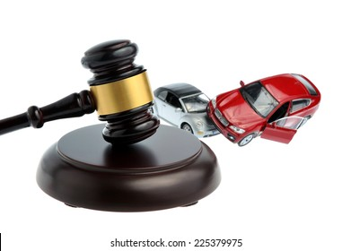 Hammer of judge with models of car accident isolated on white background
