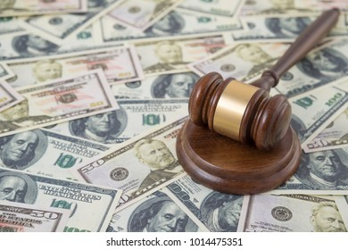 hammer of the judge on the background of money dollar banknotes. court, verdict, corruption