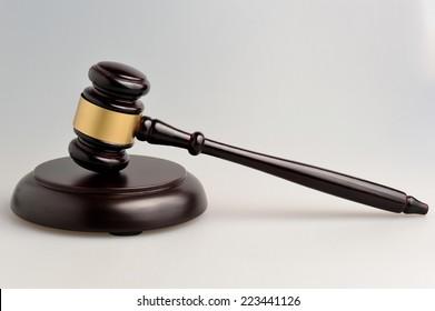 Hammer of judge on gray