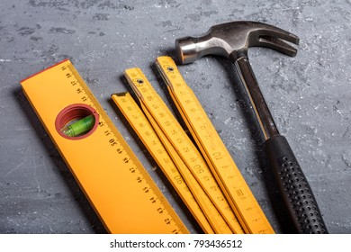 hammer,  level and folding meter on background