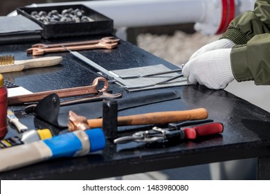 hammer and locksmith tools on the iron table