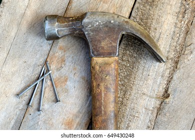 Hammer with nails on wood pallet background
