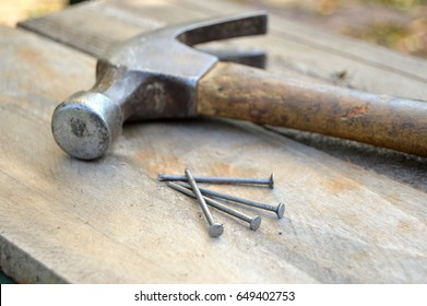 Hammer and nails on wood pallets for diy project