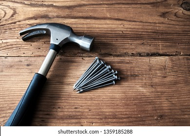 Hammer and nails on wooden background